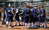 Blue Hawks welcome home #44 Jody Lantz as she crosses the plate after her 2-RBI home run.