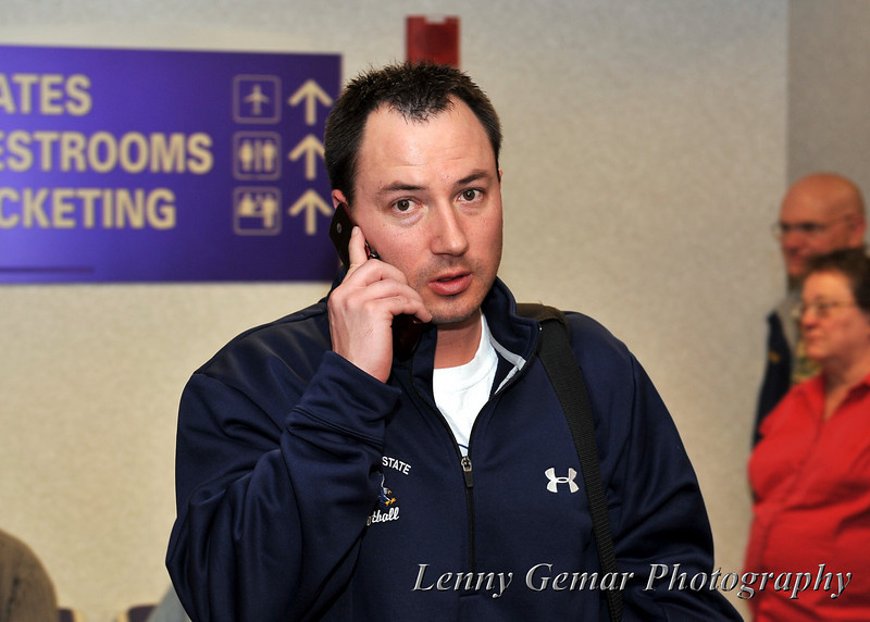 Coach Jamie Jung on an important phone call.  (Probably ordering the pizza for the team)