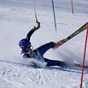 Record-Eagle/Jan-Michael Stump<br /> Traverse City West's James Mikko falls during his first run in the slalom in Monday's state ski championships at Boyne Mountain in Boyne Falls.