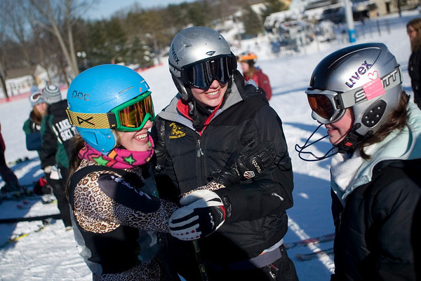 Record-Eagle/Jan-Michael Stump<br /> Traverse City Central's Adrienne Bruder, left, i greeted by Maddy McLachlan, center, and Molly Tompkins after her secong giant slalom run in Monday's tate ski championships at Boyne Mountain in Boyne Falls. McLachlan won the event.