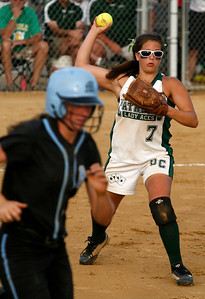 Owensboro Catholic pitcher Martina Riney throws out a Mercy baserunner during the Championship game of the 2009 KHSAA Fast Pitch softball tournament.
