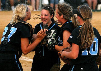 Mercy's Marissa Hobson , center, is surruonded by teammates as they celebrate a win over Owensboro Catholic in the Championship game of the 2009 KHSAA Fast Pitch softball tournament.
