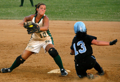 Owensboro Catholic's Meghan Sims applies a tag to Mercy's Chelsea Meiners during the Championship game of the 2009 KHSAA Fast Pitch softball tournament.