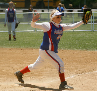 Montgomery County first baseman Haley Osborne snags a throw from home plate during the Lady Indians' game against North Laurel Friday morning during the second round of the KHSAA Fast Pitch Softball State Tournament in Owensboro, KY. Montgomery County lost 5-0, pushing them into the losers' bracket of the double-elimination tournament.