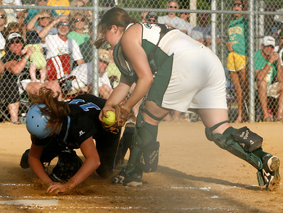 Owensboro Catholic catcher Erica Pendleton tags out Mercy baserunner Morgan Ellington during the Championship game of the 2009 KHSAA Fast Pitch softball tournament.