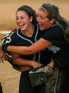 Mercy's Marissa Hobson ,left, and Kelsey Woods celebrate a win over Owensboro Catholic in the Championship game of the 2009 KHSAA Fast Pitch softball tournament.