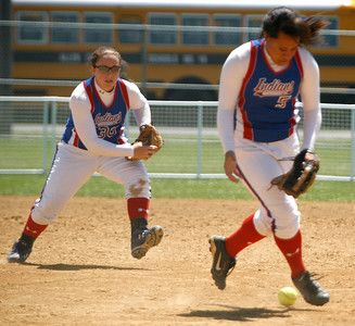 Montgomery County third baseman Lani Moala, right, fields an infield grounder during the Lady Indians' game against North Laurel Friday morning during the second round of the KHSAA Fast Pitch Softball State Tournament in Owensboro, KY. Shortstop Haley Catron, left, backs her up. Montgomery County lost 5-0, pushing them into the losers' bracket of the double-elimination tournament.