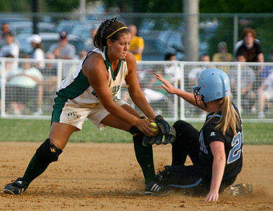 Owensboro Catholic's Meghan Sims tags out Mercy's Katie Kissel during the Championship game of the 2009 KHSAA Fast Pitch softball tournament.