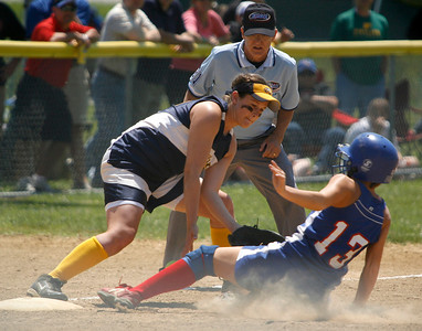 Franklin County third baseman Ashli Mayes tries to tag Allen County-Scottsville baserunner Raissa Stovall during the Flyers' game against Allen County-Scottsville Friday afternoon during the second round of the KHSAA Fast Pitch Softball State Tournament in Owensboro, KY. Stovall was safe on the play. Franklin County lost 8-2, pushing them into the losers' bracket of the double-elimination tournament.