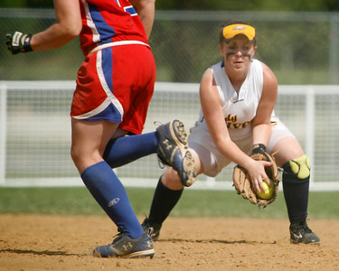 Franklin County second baseman Mollie Stephens fields a sharp grounder as a baserunner moves toward second during the Flyers' elimination bracket game against Conner during the KHSAA Fast Pitch Softball State Tournament Saturday morning at Jack Fisher Park in Owensboro, KY. The flyers stayed alive with a 3-0 win.