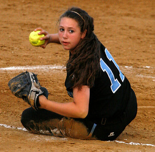 Mercy's Marissa Hobson prepares to throw to first base after a diving catch in the Championship game of the 2009 KHSAA Fast Pitch softball tournament.