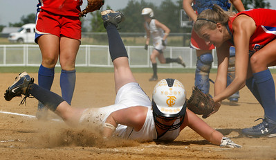 Franklin County baserunner Abby Davis slides into home while Conner pitcher Kelsey Robinson applies the tag during the Flyers' elimination bracket game against Conner during the KHSAA Fast Pitch Softball State Tournament Saturday morning at Jack Fisher Park in Owensboro, KY. Davis was safe on the play, helping her team stay alive with a 3-0 win.