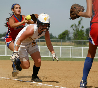 Franklin County baserunner Abby Davis runs for home while Conner Third baseman Katelyn Willims throws the ball ahead during the Flyers' elimination bracket game against Conner during the KHSAA Fast Pitch Softball State Tournament Saturday morning at Jack Fisher Park in Owensboro, KY. Davis slid home safely, helping the flyers stay alive with a 3-0 win.