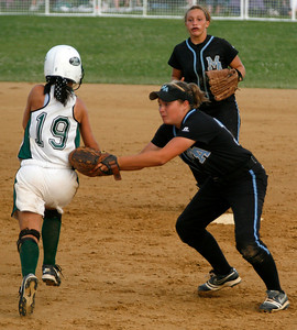 Mercy's Amanda Schumacher tags out Owensboro Catholic's Sarah Babb during the Championship game of the 2009 KHSAA Fast Pitch softball tournament.
