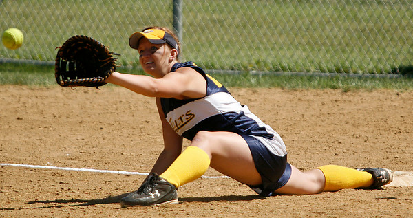 Franklin County first baseman Heather Redmon stetches for a throw  during the Flyers' game against Estill County Friday morning during the second round of the KHSAA Fast Pitch Softball State Tournament in Owensboro, KY. Franklin County won 4-0, advancing into a second-round matchup against Allen County-Scottsville in the double-elimination tournament.