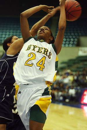 Amanda Jones is  fouled as she drives to the basket. (Charles A. Smith/Special to the Daily Journal)