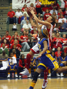 Krystal Jackson drives to the basket. (Charles A. Smith/Special to the Daily Journal)