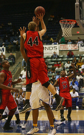 Beau Cummings shoots over a defender. (Charles A. Smith/Special to DJournal)