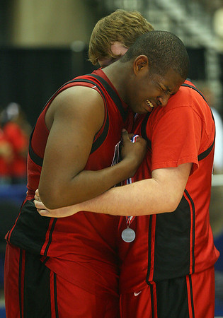 Jimel Judon is consoled by an unidentified teammate. (Charles A. Smith/Special to DJournal)