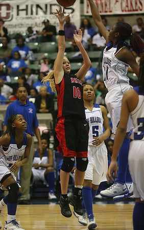 Amber Williamson shoots over a McAdams defender. (Charles A. Smith/Special to the Journal)