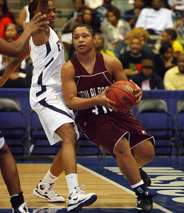 Kebrina Lucas drives the baseline. (Charles A. Smith/Special to the Daily Journal)