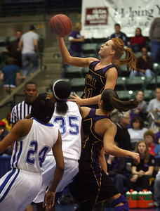 Tatum Lewis drives down the lane past defenders. (Charles A. Smith/Special to the Daily Journal)