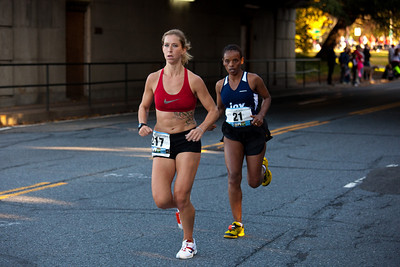 eventual female winner 21 MULIYE GURMU of Ethiopia at mile 10 trailing 217 MELINDA KEESEE of Arlington VA