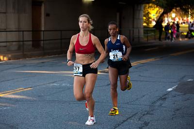 eventual female winner 21 MULIYE GURMU of Ethiopia at mile 10 trailing 217 MELINDA KEESEE of Arlington VA