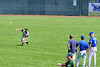 aCUE_4989  Ken Stone throws during outfield drills under the watchful eyes of three Kansas City Royals scouts.