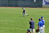 aCUE_5034  Christian Santana tracks a ball during outfield drills while three Kansas City Royals scouts look on.