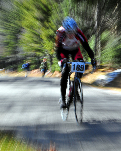 "Sam Anderson of Kearsarge NH, competes in stage 1, ""The Toughest Two"", of The Porky Gulch Classic - a 2 day bike racing event with 3 stages.<br /> Here, Mr. Anderson, 19, powers his bike two miles up the Mt. Washington Auto Road, on Saturday, November 7th, racing to a 7th place finish in the Elite class division."