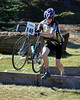 "Fourteen year-old, Sean Doherty of Center Conway, NH, carries his bike over the barriers, during ""Rockpile Revenge"", the third stage of The Porky Gulch Classic, contested on November 7th & 8th, 2009, and organized by Great Glen Trails of Gorham."