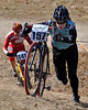 "Tamela Lynch, of Littleton, NH, pushes her bike up a steep hill, during ""Rockpile Revenge"" -the third and final stage of the 2009 Porky Gulch Classic, held Nov. 7th & 8th, at Great Glen Trails in Gorham."