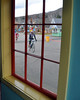 Ryan Littlefield, of Scarborough, ME, is seen through a window at Story Land in Glen, during The Story Land Criterium -the second leg of The Porky Gulch Classic, on Saturday, Nov. 7th.<br /> Mr Littlefield went on to win the men's overall title as champion of the 2009 Porky Gulch Classic, by winning the final event -Rockpile Revenge, which was a classic cyclecross race.