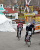 Michael Daubenspeck, of North Conway, stays just ahead of Larry Reed (150), during the Story Land Criterium, the 2nd of 3 stages in The Porky Gulch Classic, organized by Great Glen Trails. The event was contested over two days, Nov. 7th & 8th, 2009.