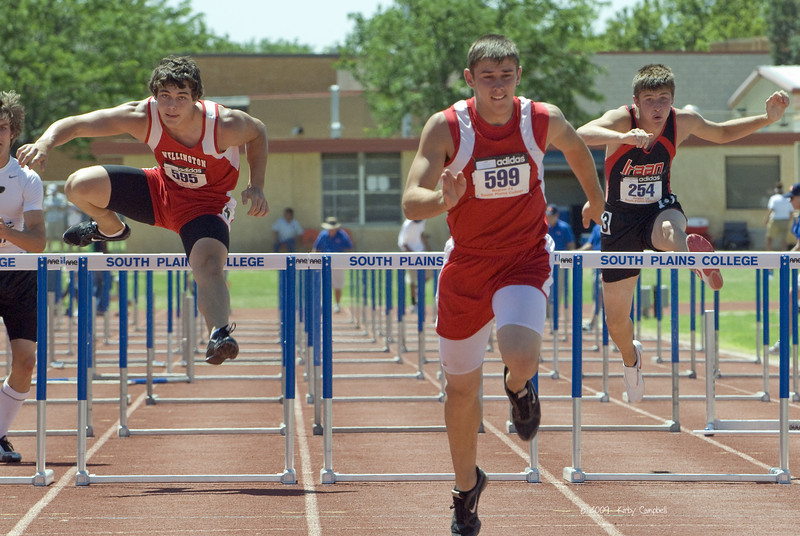 Eric Needham clears his final hurdle for second place; 110 Meter High Hurdles.