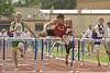Eric Needham; qualifying heat - 110 meter High Hurdles.