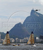 """Yachts Telefonica Black, left, and Telefonica Blue, right, take part in the Rio de Janeiro in-port race during the 2008-2009 Volvo Ocean Race at Guanabara bay, Rio de Janeiro, Brazil, April 4, 2009. In the background, the Corcovado mountain with the """"Christ the redeemer"""". The Spanish boat """"Telefonica Blue"""" won the competition. (Austral Foto/Renzo Gostoli)"""