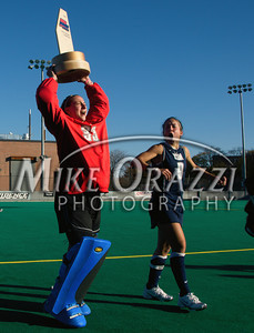 University of Connecticut field hockey goalie Andrea Mainiero and Melissa Gonzalez celebrate after winning the 2009 Big East Field Hockey Championship at Providence College on Sunday, November 8, 2009. The Huskies defeated Syracuse 2-1. (photo by Mike Orazzi)