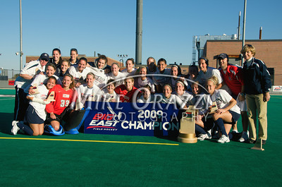 Members of the University of Connecticut field hockey team  celebrate after winning the 2009 Big East Field Hockey Championship at Providence College on Sunday, November 8, 2009. The Huskies defeated Syracuse 2-1. (photo by Mike Orazzi)