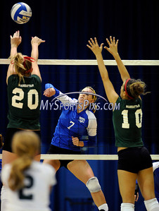 CCSU's Jamie Baumert (7) at the net with Manhattan College's Rita Welsh (20) and Laura Bellotti (10) during Friday's volleyball match in New Britain.