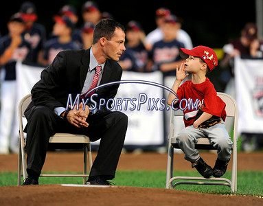 8/7/2009 Mike Orazzi | Staff Corey Wright talks with five-year-old Tyler Smith before Smith threw out the ceremonial first pitch during the 2009 Eastern Regional Little League Tournament in Bristol, Conn., on Friday, August 7, 2009.