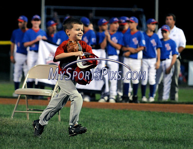 8/7/2009 Mike Orazzi | Staff Five-year-old Tyler Smith runs off the field after throwing out the ceremonial first pitch during the 2009 Eastern Regional Little League Tournament in Bristol, Conn., on Friday, August 7, 2009.
