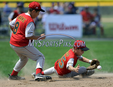 8/7/2009 Mike Orazzi | The Staff Maryland's Sinjin Shoop (15) has some trouble with a hard hit ball as teammate Blake Harne looks on during an 8-5 loss to Delaware in the first game of the 2009 Eastern Regional Little League Tournament in Bristol, Conn., on Friday, August 7, 2009.