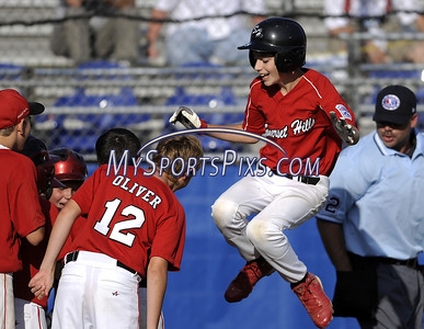 8/7/2009 Mike Orazzi | Staff New Jersey's Danny McDonnell (5) leaps toward home plate after his home run during a 5-2 win over the District of Columbia during the 2009 Eastern Regional Little League Tournament in Bristol, Conn., on Friday, August 7, 2009.