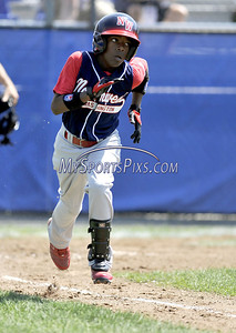 8/10/2009 MIke Orazzi | Staff The District of Columbia's DeAndre Cash (23) on his way to first base after a single during a loss to Maryland in the 2009 Eastern Regional Little League Tournament in Bristol, Conn., on Monday, August 10, 2009.
