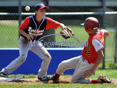 8/10/2009 MIke Orazzi | Staff Maryland's Jordan Stonebreaker (22) slides safely into third as the District of Columbia's Tommy Crittenberger (6) has some trouble catching the ball during  the 2009 Eastern Regional Little League Tournament in Bristol, Conn., on Monday, August 10, 2009.