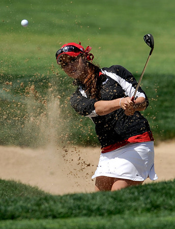 Skyline's Gina Larson chips out of the sand on number 9 during the 5A State Golf Championships at Common Ground Golf Course in Denver, Colorado May 24, 2010.  CAMERA/Mark Leffingwell