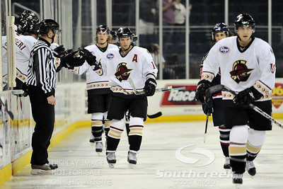 Gwinnett players give each other high fives after scoring a goal in ECHL Hockey action between South Carolina and Gwinnett.  South Carolina defeated Gwinnett 5-2 in the game at The Arena at Gwinnett in Duluth, GA.