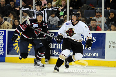 South Carolina forward Jake Hauswirth (#20) and Gwinnett defenseman Tim Filangieri (#5) attempt to get back into the action in ECHL Hockey action between South Carolina and Gwinnett.  South Carolina defeated Gwinnett 5-2 in the game at The Arena at Gwinnett in Duluth, GA.